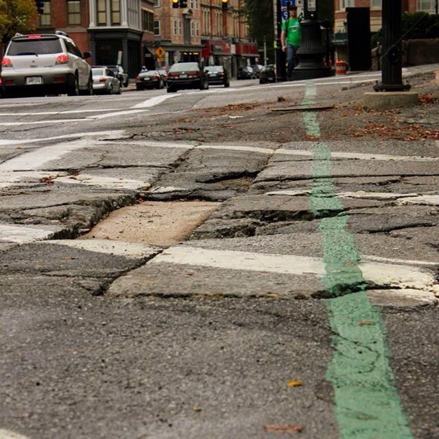stock-photo-light-street-green-traffic-providence-lines-decay-potholes-ig-561634306434177013_30282980